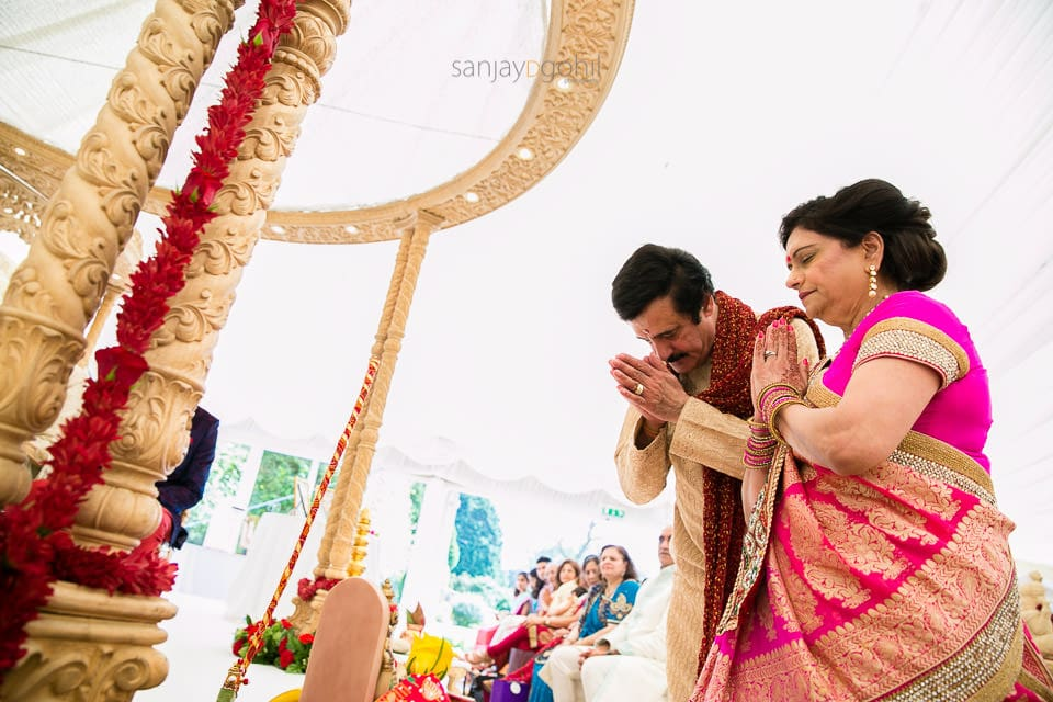 Parents of the bride praying to Lord Ganesh