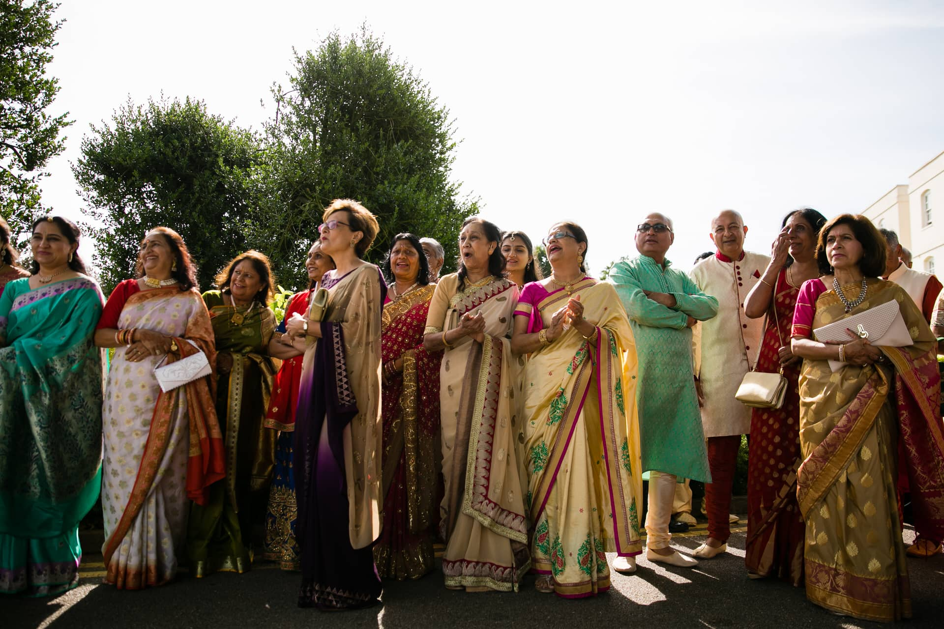 Asian wedding guests arriving for wedding ceremony