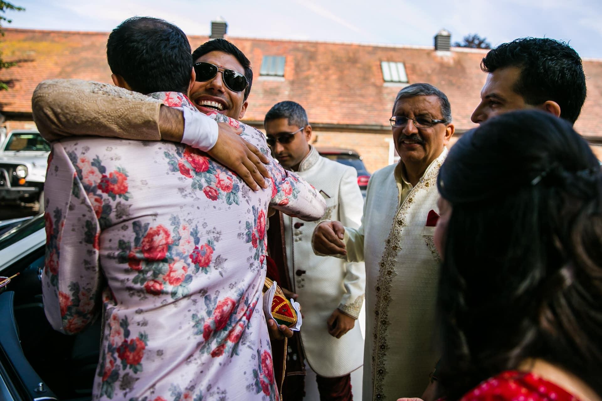 Wedding groom hugging