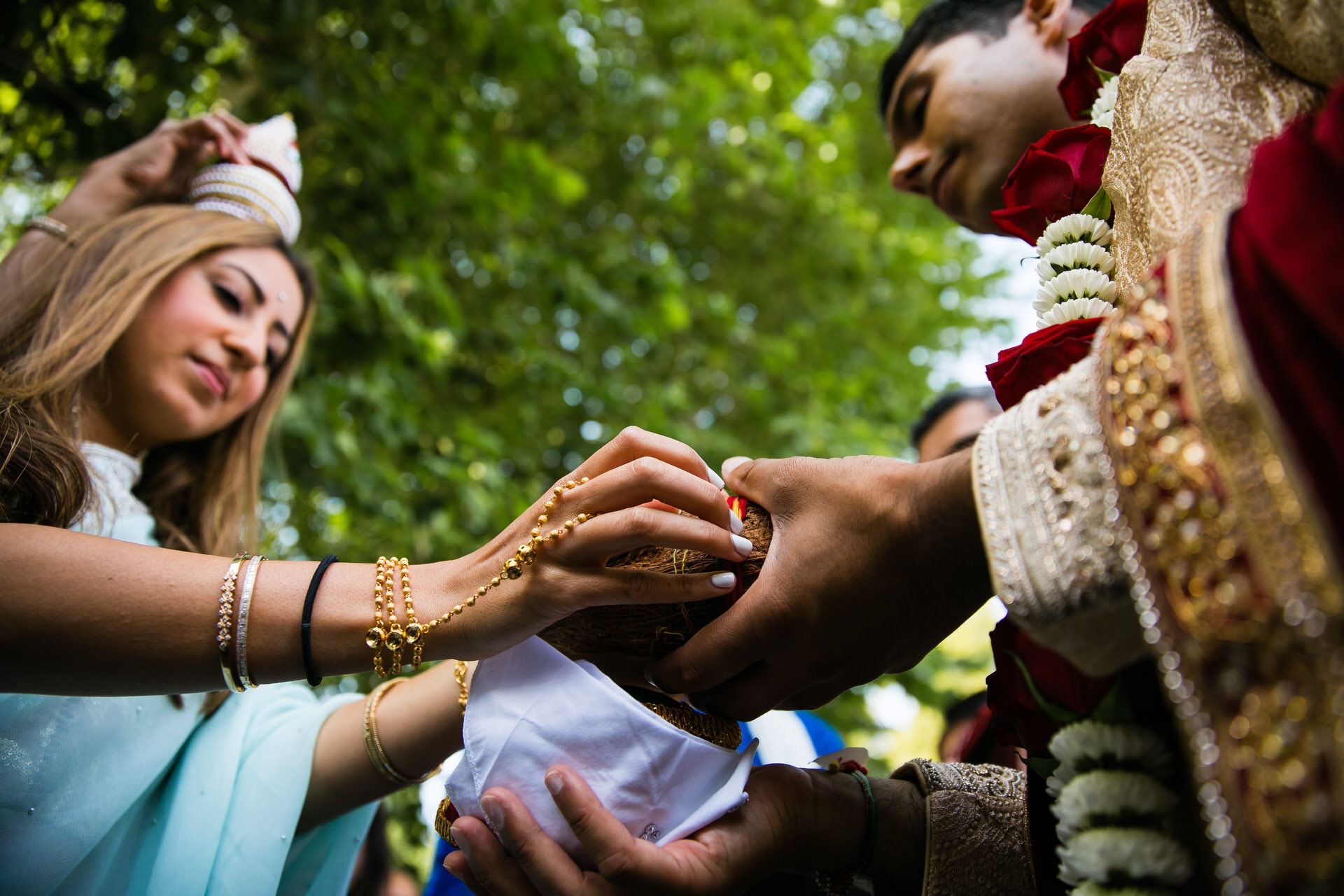 Coconut exchange ceremony during Hindu wedding