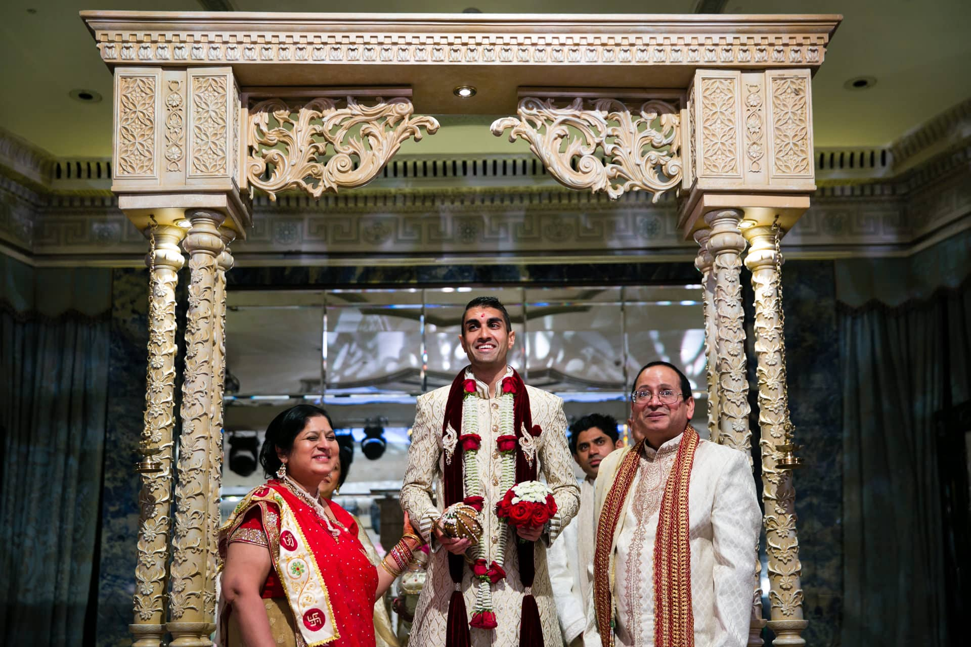 Asian Wedding bride's family welcoming groom