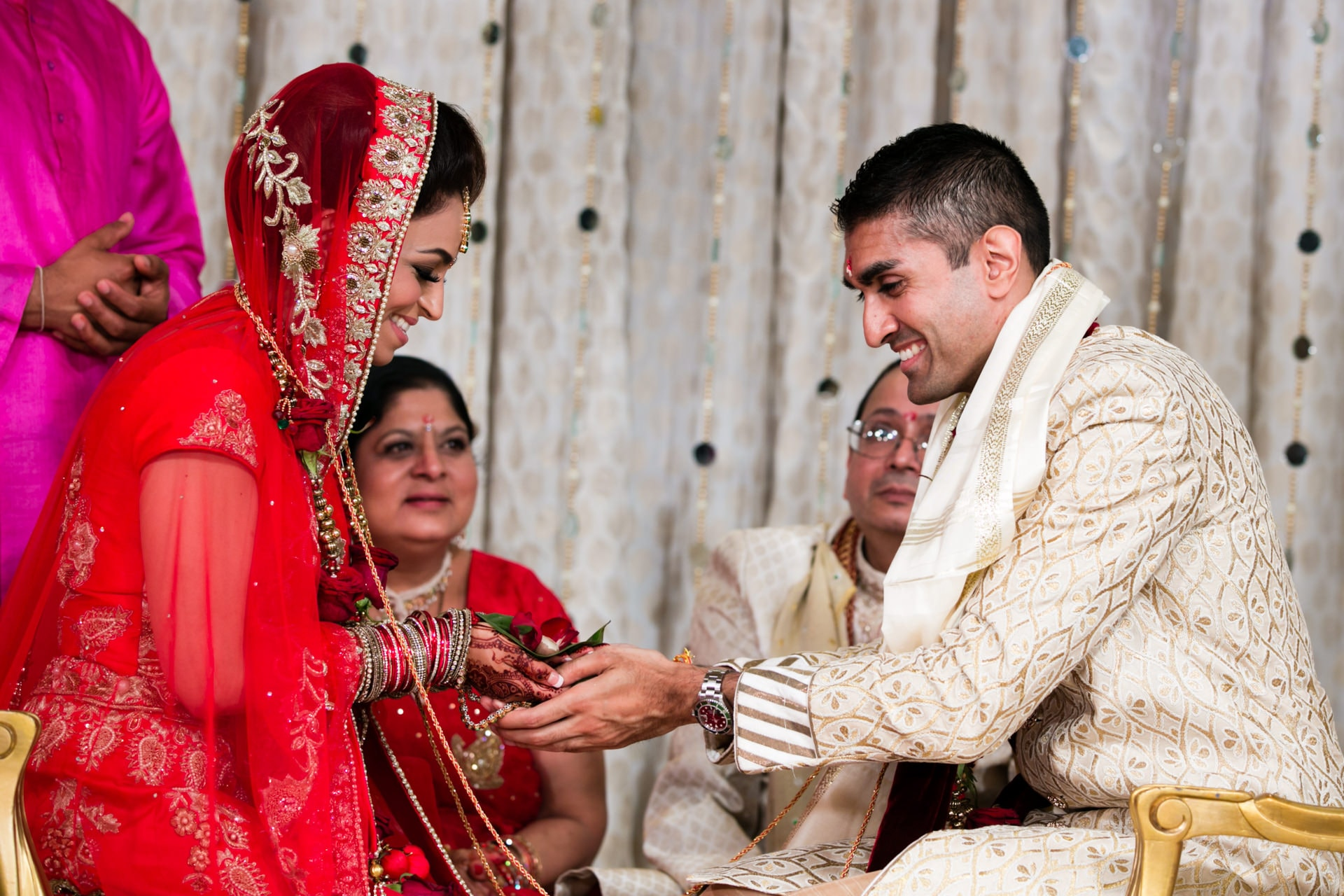 Smiling asian bride and groom during Hindu Wedding