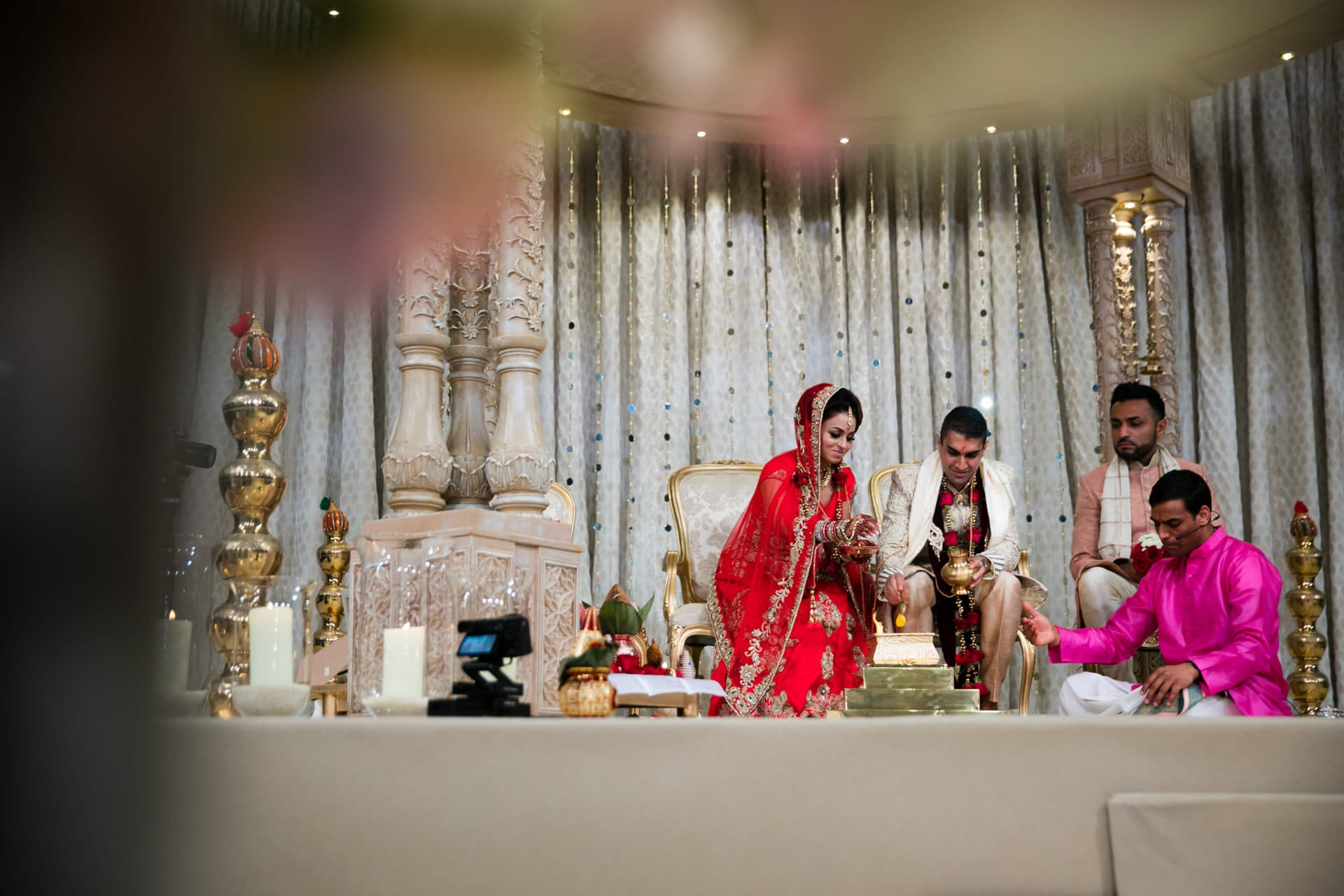 Hindu wedding couple performing Hindu wedding ceremony
