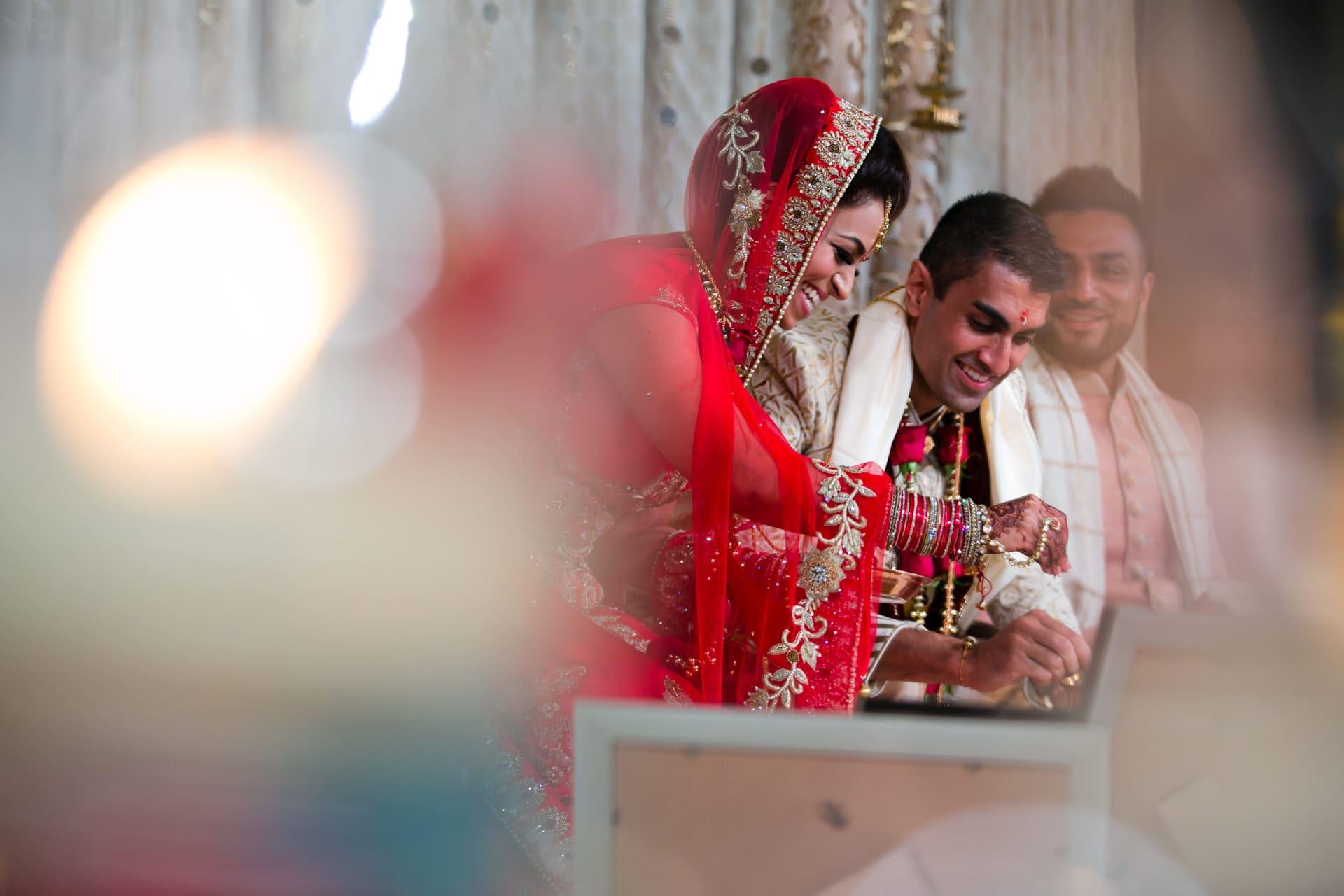 Hindu wedding couple performing Hindu wedding ceremony