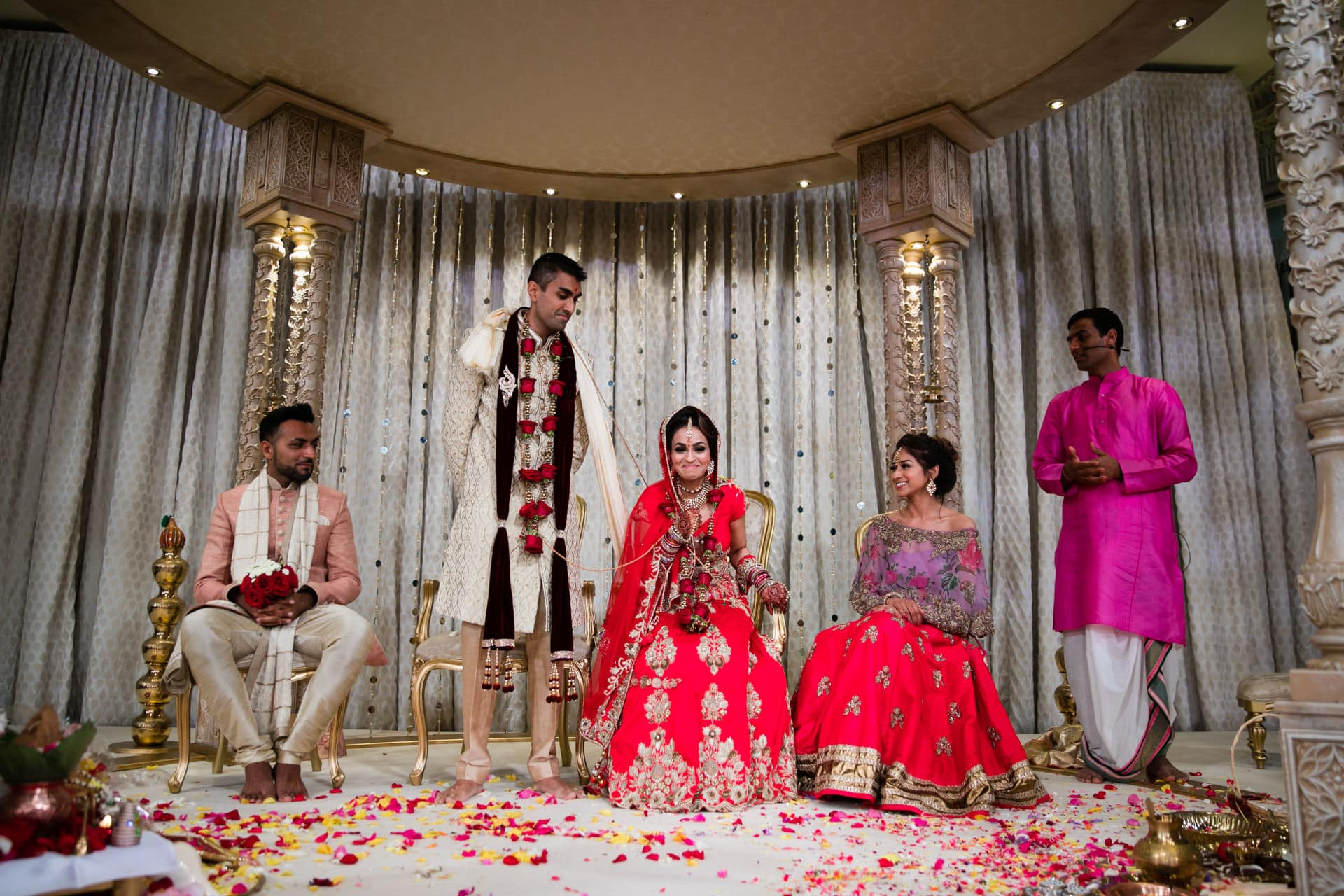 Hindu Bride sits down before the groom does