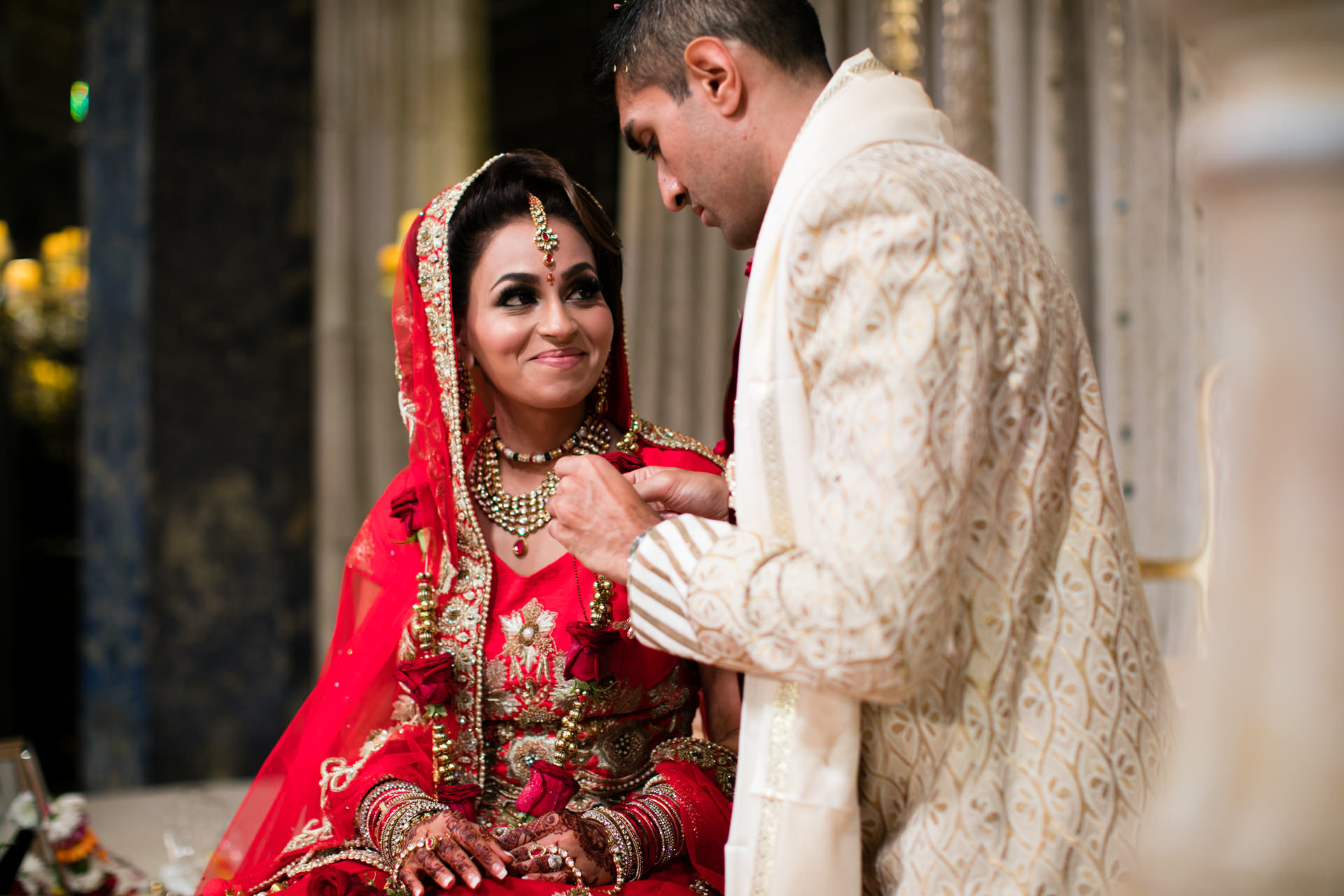 Bride smiling at groom during Indoor ceremony