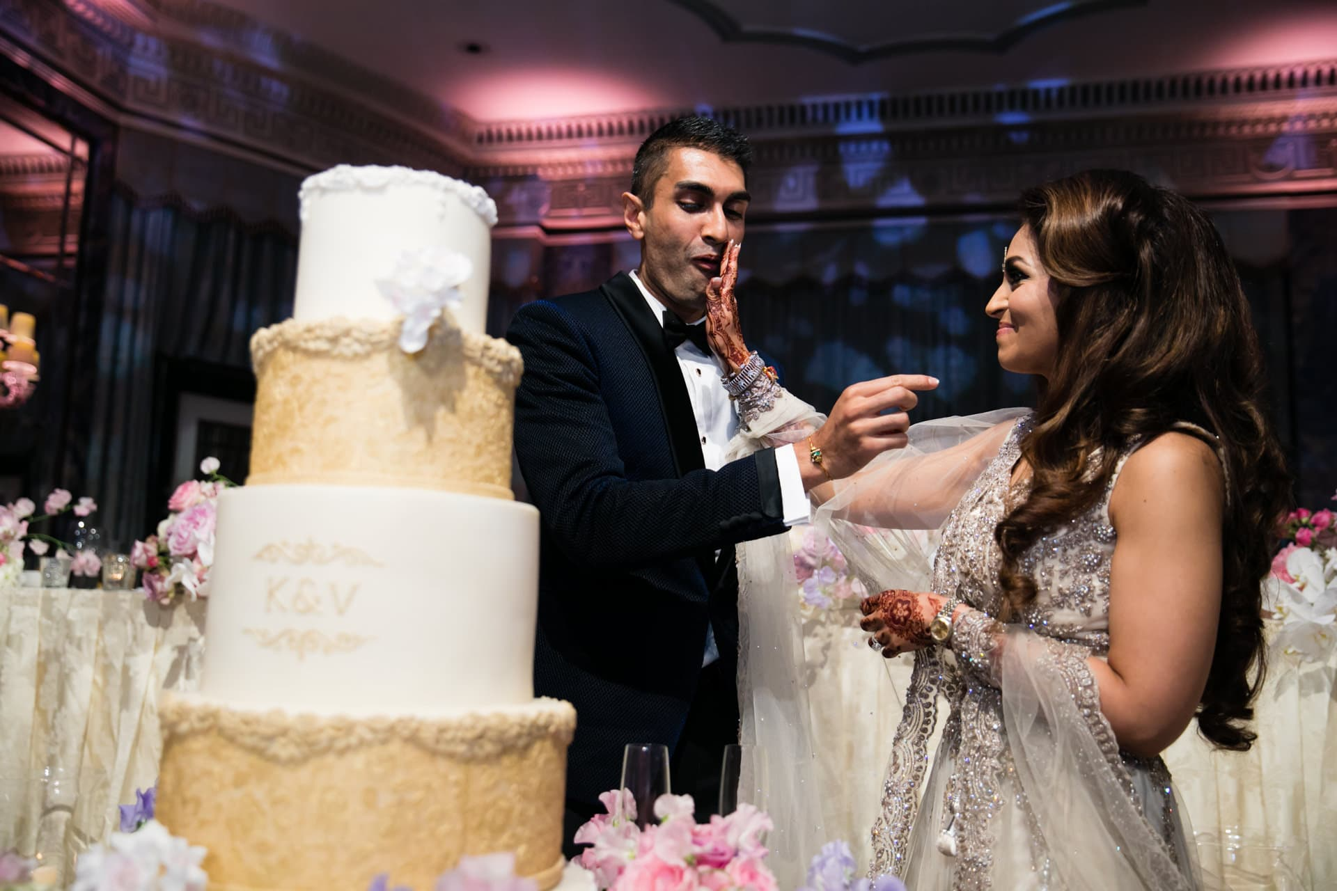 Asian wedding couple by the cake