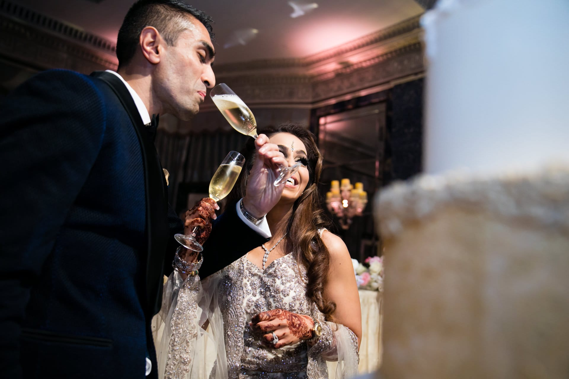 Groom sipping champagne