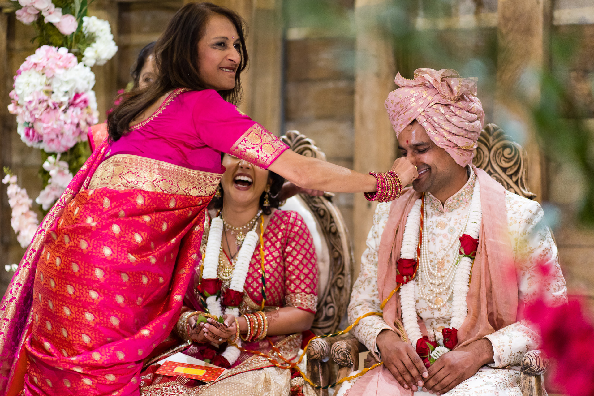 Groom's nose being pinched during Gujarati wedding