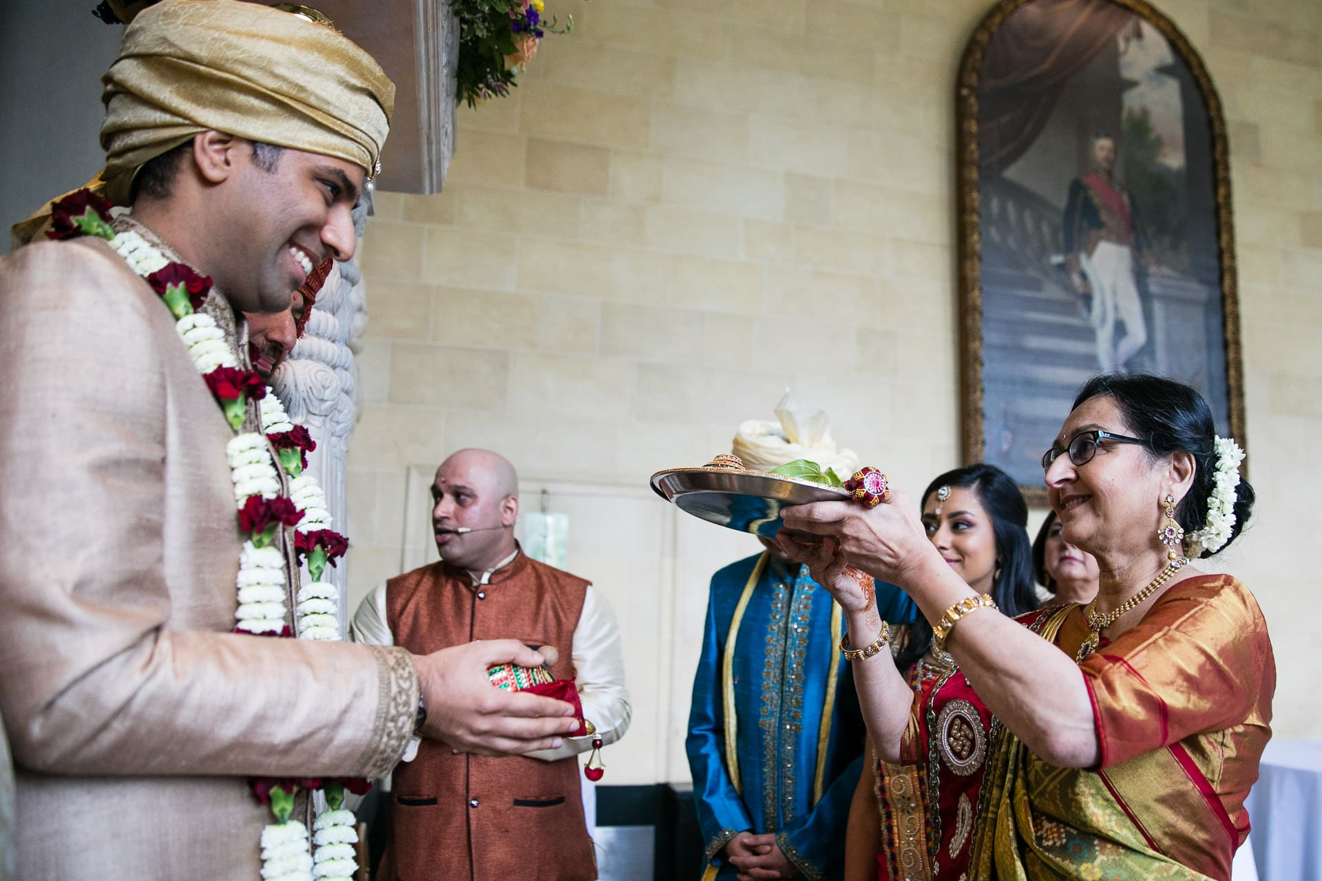 Mother of the bride performing Gujarati wedding ritual
