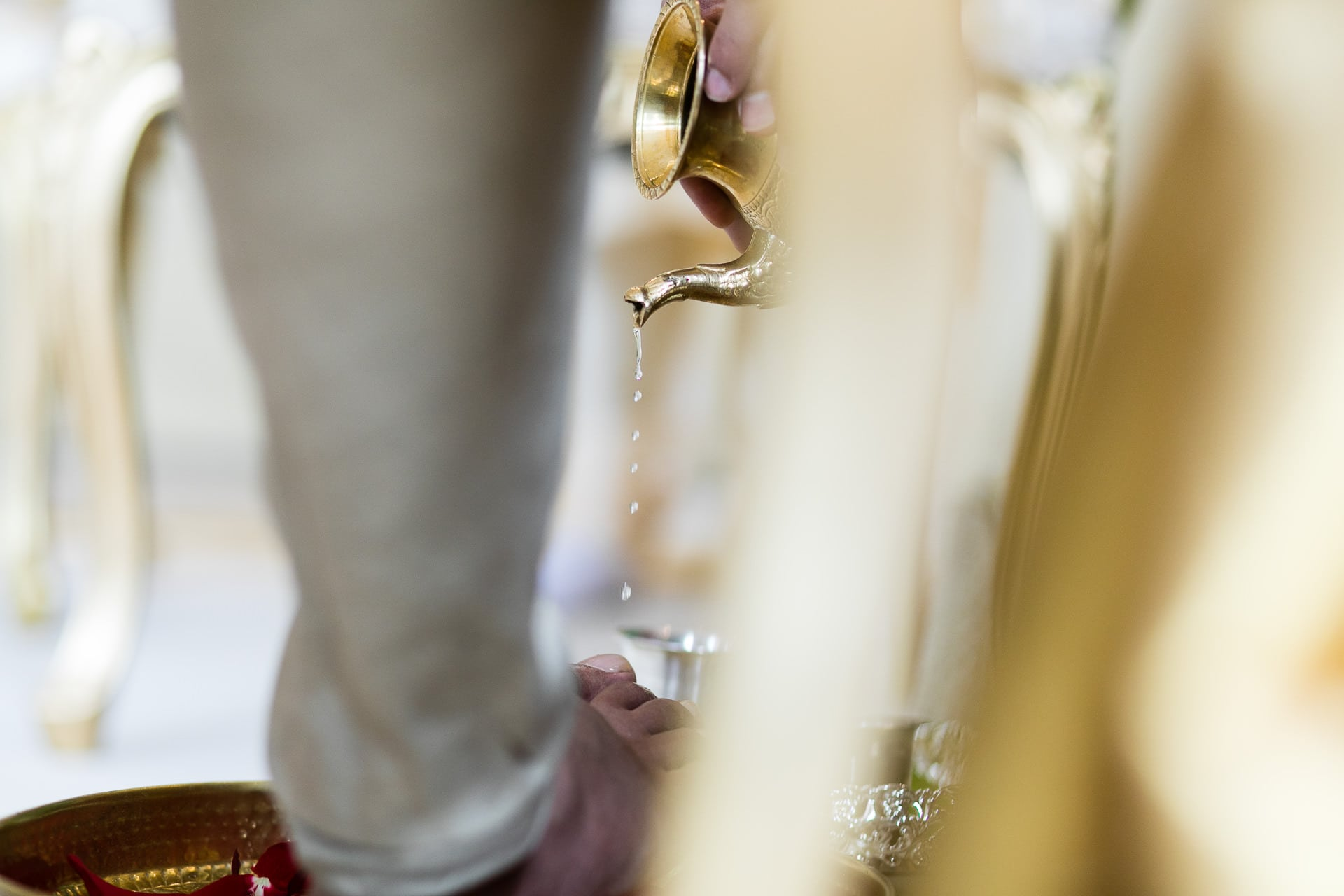 Water being poured onto the feet of the groom