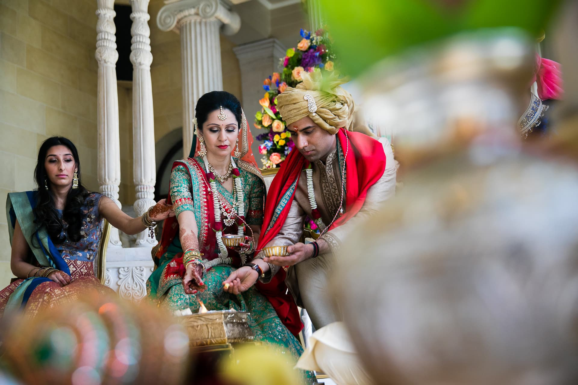 Hindu Wedding couple offering seeds into the fire