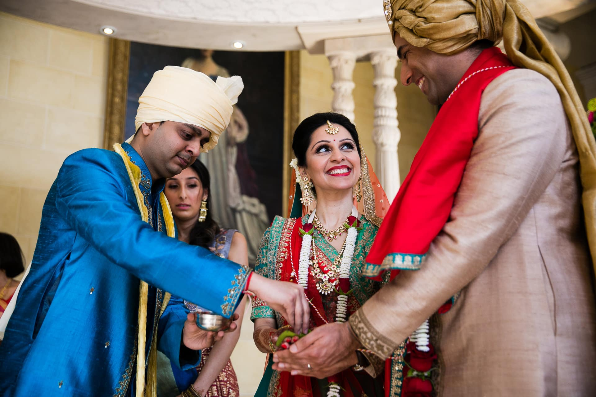 Brother of bride offering seeds to bride and groom