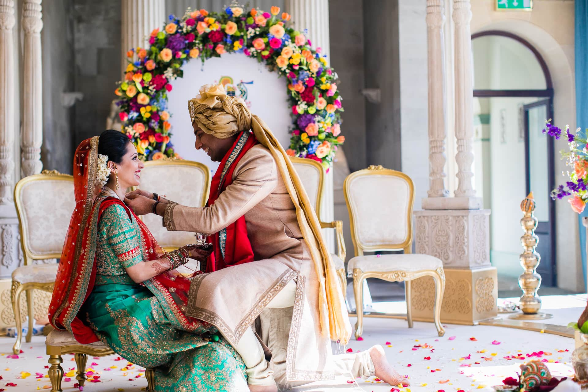 Groom putting Mangal Sutra onto bride