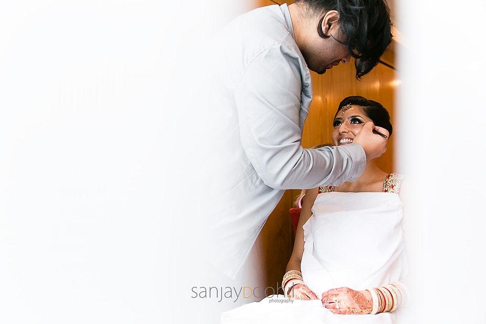 Hindu Bride getting ready by Jawaad Ashraf makeup artist