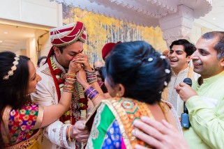 Asian Wedding groom having his nose pinched