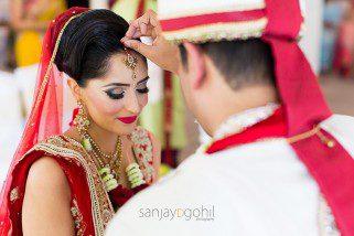 Sindoor being put onto Hindu Wedding Bride
