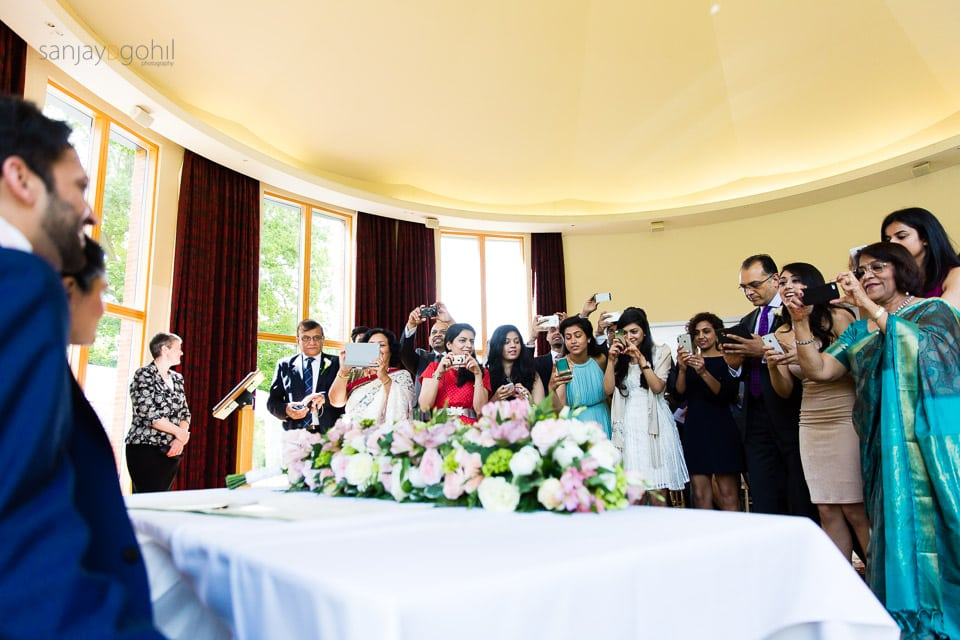 Wedding guests taking photographs at Saville Court