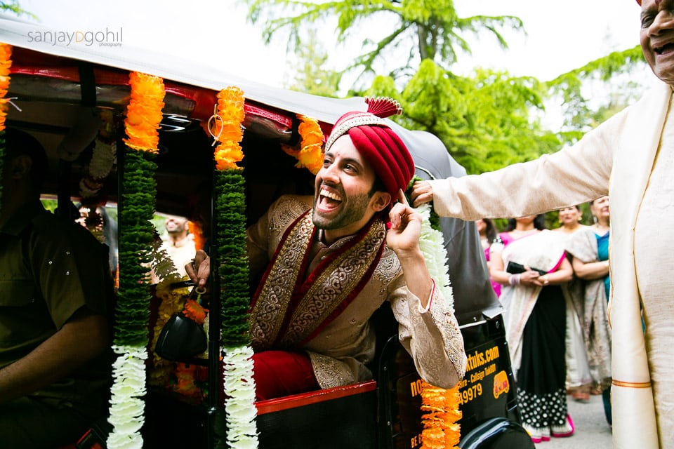 Hindu Groom smiling in Rickshaw