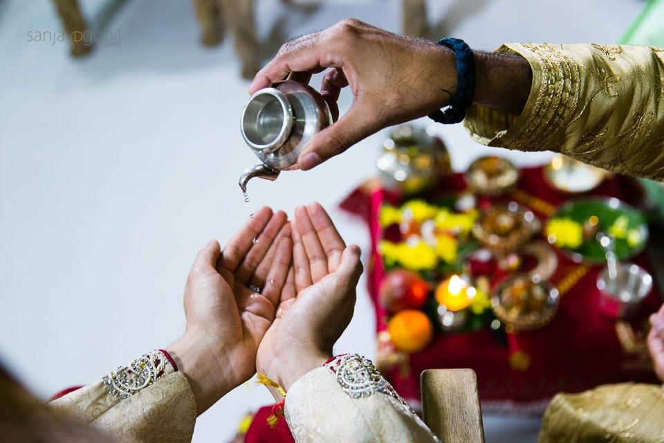 Water being poured in the hindu groom's hands
