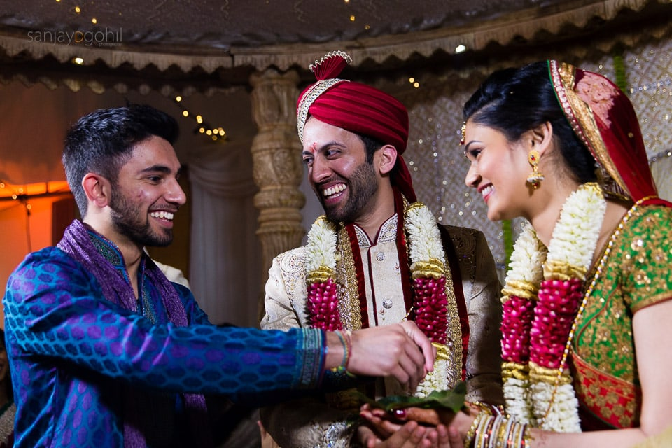 Bride and Groom laughing during Hindu Wedding ceremony