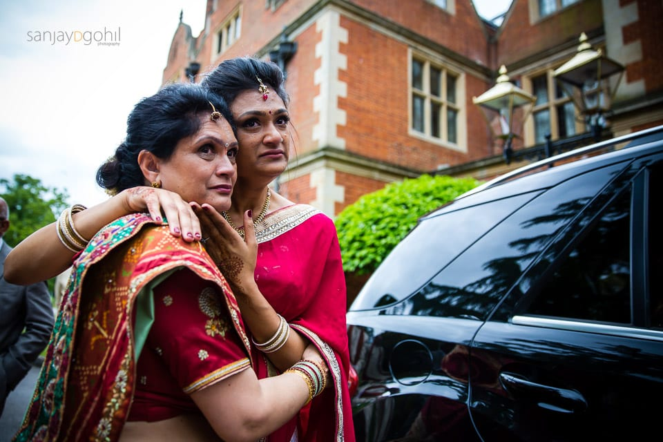 Mum and sister hugging after the vidhai