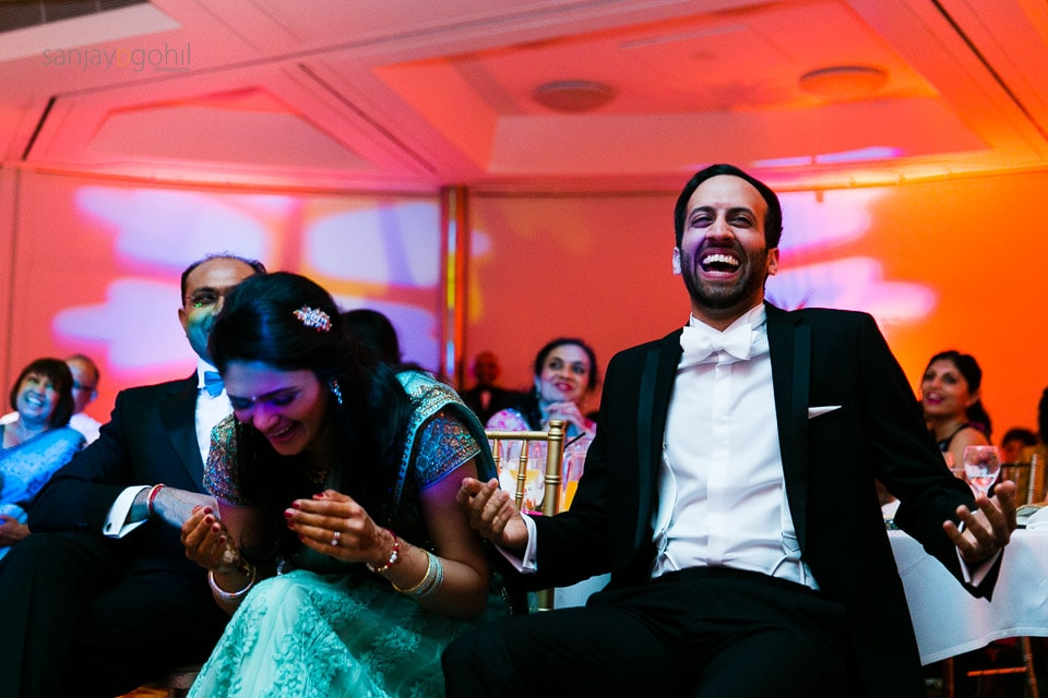 Bride and Groom laughing during speeches at reception party