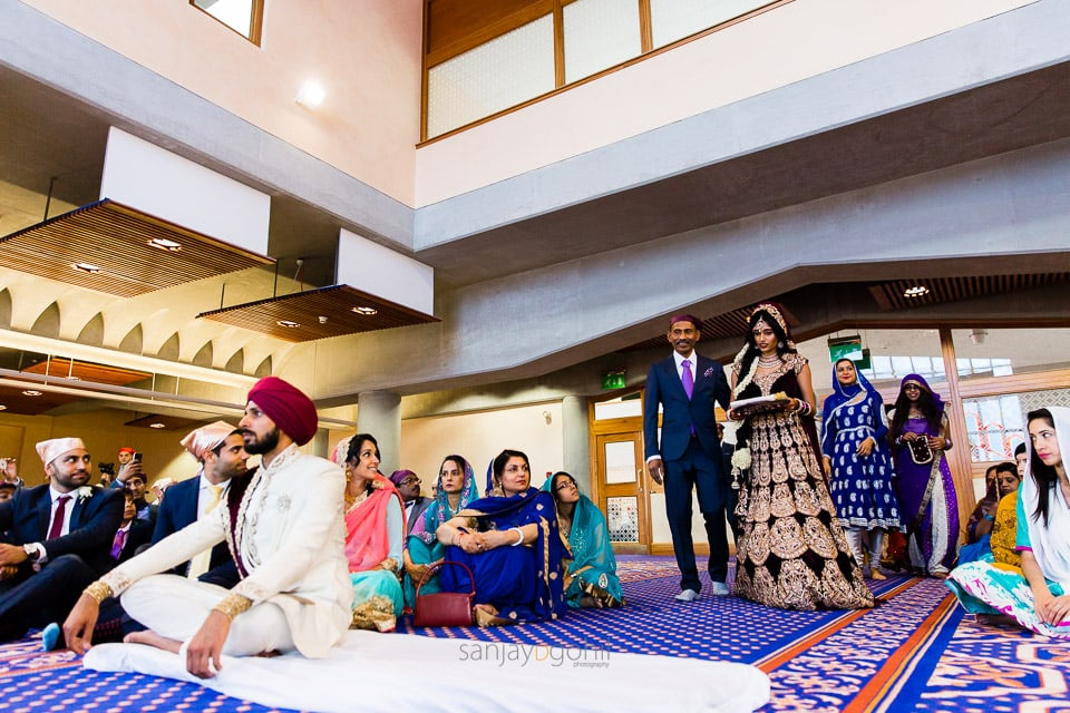 Bridal entrance during Sikh wedding ceremony