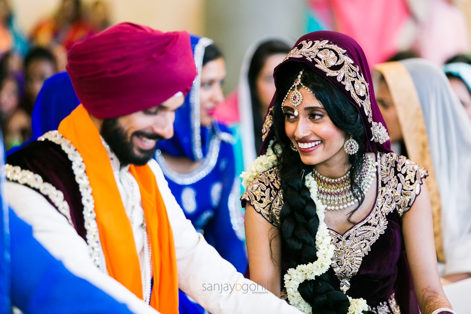 Bride and Groom laughing after sikh wedding ceremony