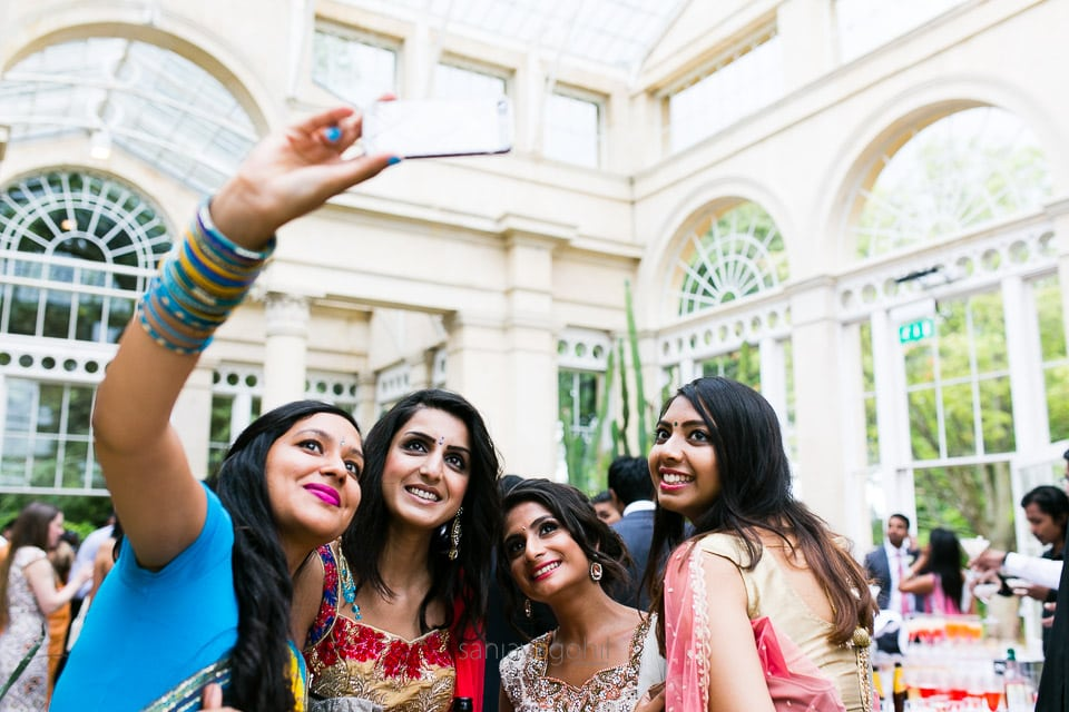 Asian Wedding guests taking a selfie