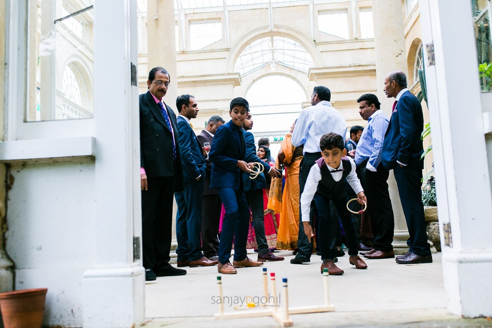 Asian Wedding guests playing games