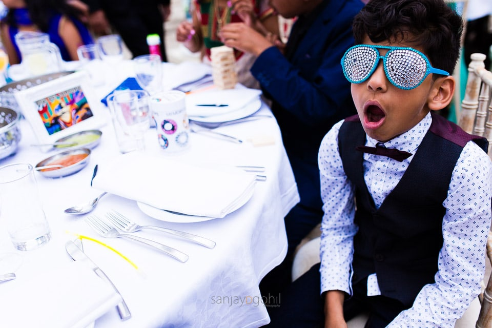 Wedding guest with funny glasses on