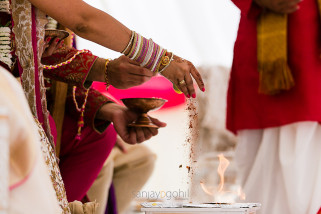 Seeds being poured into the fire during Hindu wedding ceremony