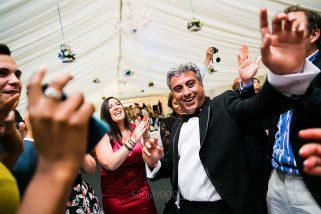 Asian wedding guests dancing