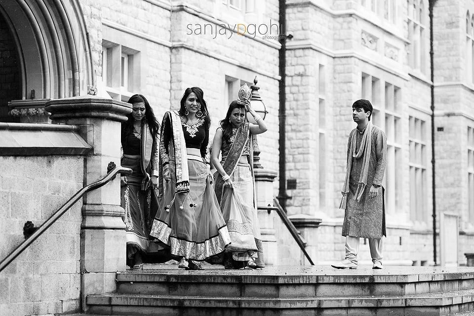 Sisters of Hindu Bride greeting groom