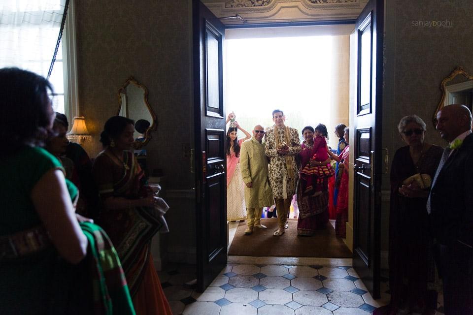 Wedding groom walkinginto Hedsor House
