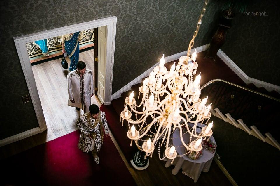 Asian Wedding Groom walking to Mandap