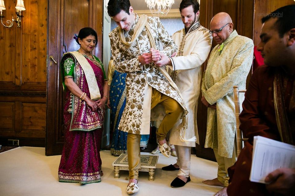Groom stepping on clay pot during Hindu Wedding