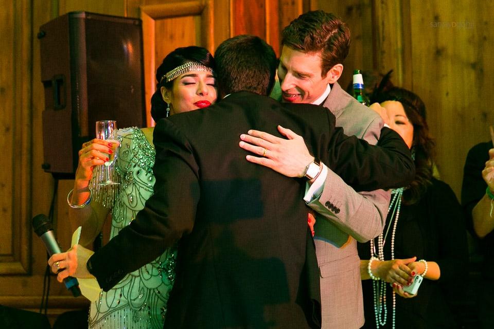 Bride and groom hugging best man