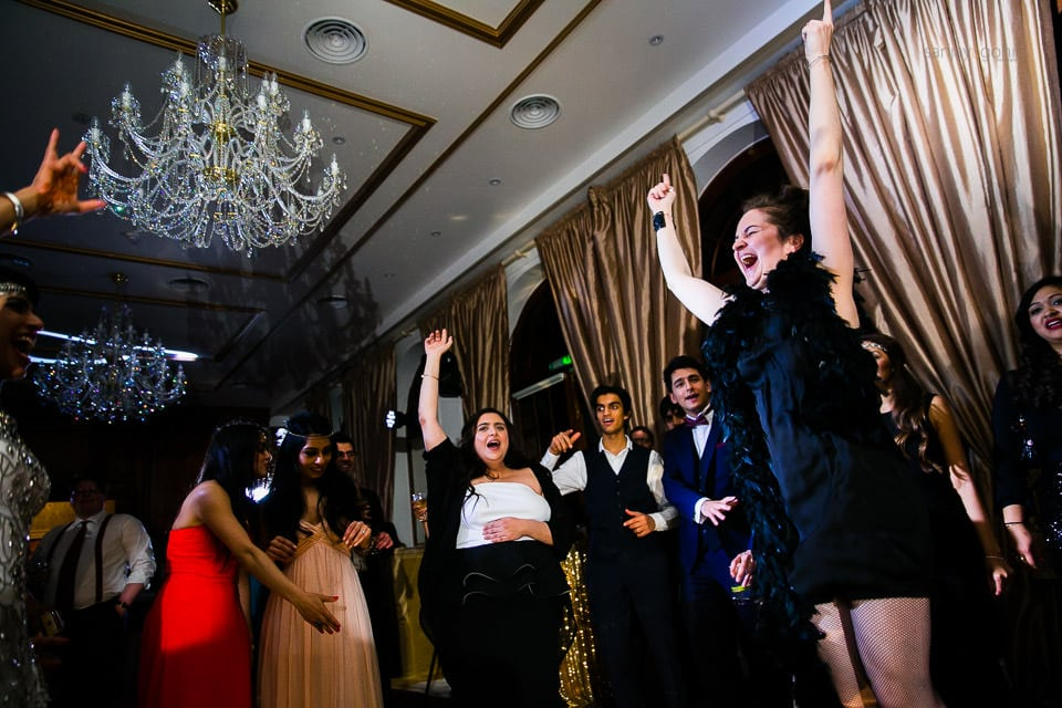 Wedding guests dancing during reception party at Hedsor House