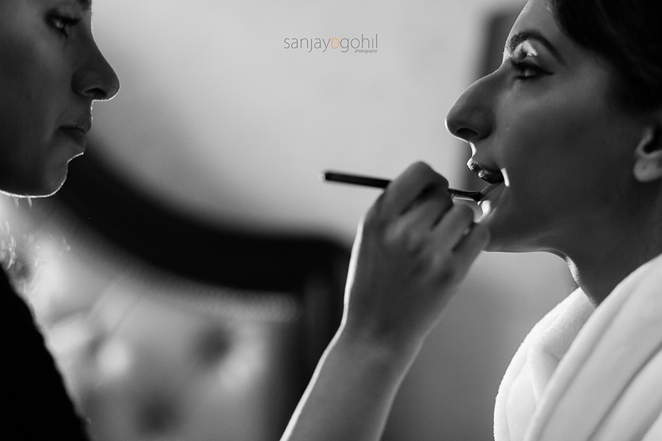 Closeup of asian wedding bride getting ready
