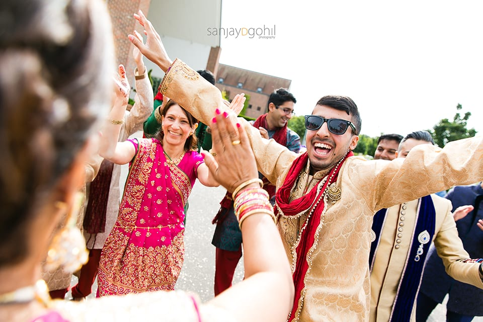 Dancing during asian wedding groom arrival