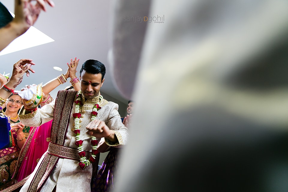 Hindu wedding groom dancing