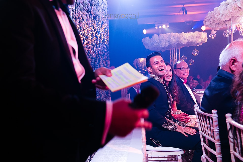 Groom laughing during wedding speech
