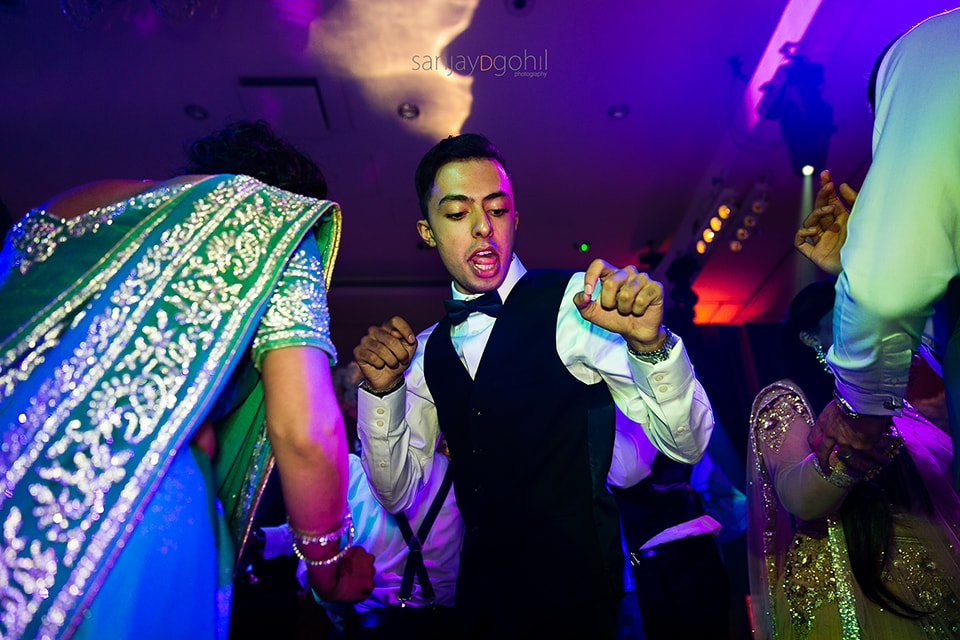 Asian wedding guests dancing