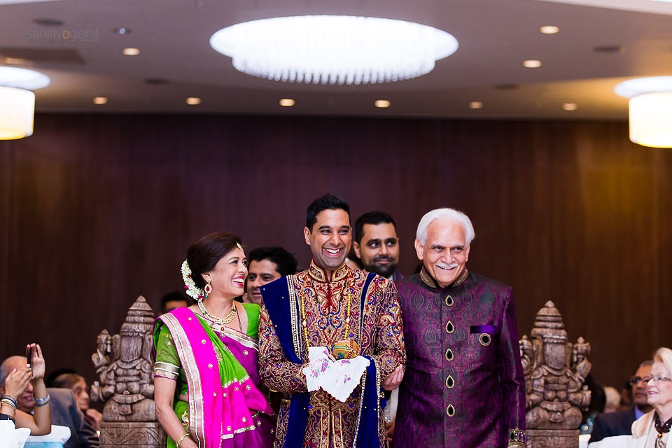 Hindu Wedding groom being escorted to the Mandap by Bride's parents