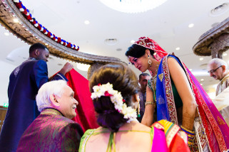 Bride smiling at father during asian wedding