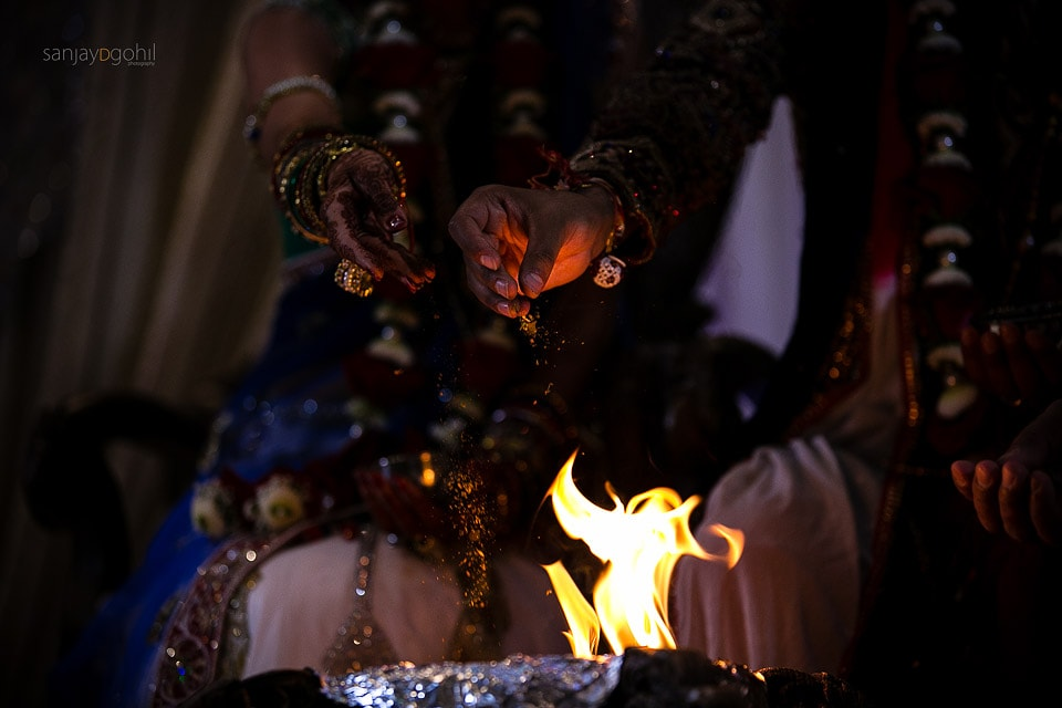Seeds being poured into the fire during Gujarati wedding ceremony