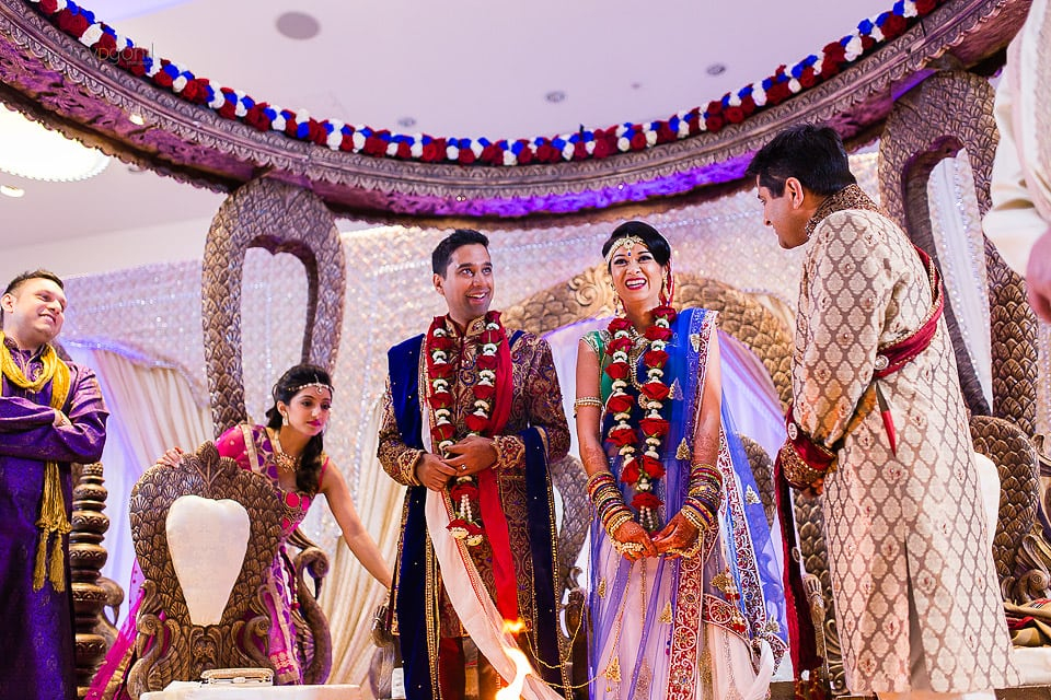 Asian Wedding bride and groom laughing