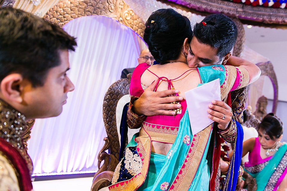 Groom hugging bride's mother